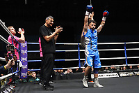 Lee Haskins (blue gloves) defeats Sergio Gonzalez during a Boxing Show at Whitchurch Leisure Centre on 5th October 2019. Lee Haskins and his son Anton Haskins both appeared on the same card, Anton making his professional debut.