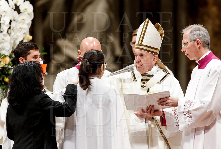 Pope Francis gives the confirmation to a woman during the Easter vigil ceremony in St. Peter's Basilica at the Vatican, April 20, 2019.<br /> UPDATE IMAGES PRESS/Riccardo De Luca<br /> <br /> STRICTLY ONLY FOR EDITORIAL USE