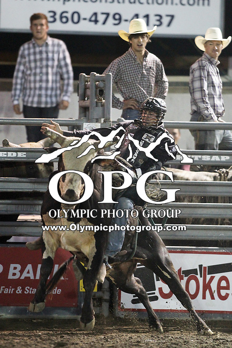 20 Aug 2014:  Beau Hill was not able to score while competing in the Seminole Hard Rock Extreme Bulls competition at the Kitsap County Stampede in Bremerton, Washington.
