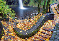 Horsetail falls and rock path with fall colored maple leaves. Columbia River Gorge National Scenics Area.  Oregon