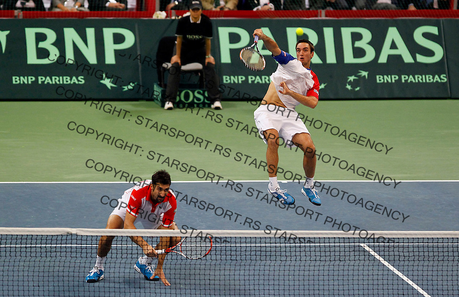Serbian Davis Cup team player Novak Djokovic reacts during dubles match Nenad Zimonic and Viktor Troicki   against Michael Llodra and Arnaud Clement of France , Davis Cup finals, Serbia vs France in Belgrade Arena in Belgrade, Serbia, Saturday, 4. December 2010.