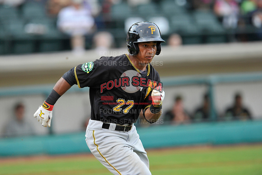 Left fielder Victor Fernandez (27) of the Bristol Pirates runs out a ground ball in a game against the Pulaski Yankees on Tuesday, July 5, 2016, at Calfee Park in Pulaski, Virginia. Pulaski won, 6-3. (Tom Priddy/Four Seam Images)