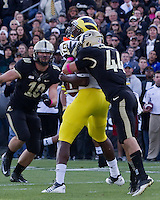 Michigan tight end Devin Funchess (19) makes a catch while being hit by Purdue safety Landon Feichter (44). Purdue linebacker Sean Robinson (10) watches the play. The Michigan Wolverines defeated the Purdue Boilermakers 44-13 on October 6, 2012 at Ross-Ade Stadium in West Lafayette, Indiana.