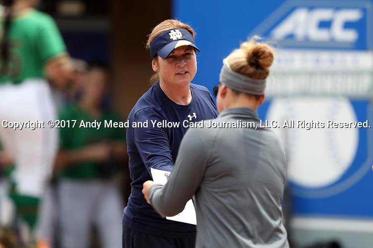CHAPEL HILL, NC - MAY 11: Notre Dame head coach Deanna Gumpf (behind) exchanges rosters with Boston College head coach Ashley Obrest. The #4 Boston College Eagles played the #5 University of Notre Dame Fighting Irish on May 11, 2017, at Anderson Softball Stadium in Chapel Hill, NC in a 2017 Atlantic Coast Conference Tournament Quarterfinal Softball game. Notre Dame won the game 9-5 in eight innings.