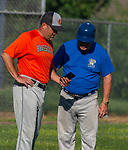 WALLINGFORD, CT-071620JS10—Brass City Bomber coach Tim Belcher and Wallingford Silver Storm coach Matt Altueri listen to a phone call and had to postpone their game on Thursday die to COVID-19 concerns at Pat Wall Field  in Wallingford. <br /> Jim Shannon Republican-American