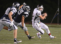 NEWTOWN, PA - SEPTEMBER 19: Central Bucks East quarterback Connor O'Keefe is chased by Council Rock North's Kyle Thorpe #79 and Thomas Hewitt #40 in the second quarter September 19, 2014 at Council Rock North in Newtown, Pennsylvania. (Photo by William Thomas Cain/Cain Images)