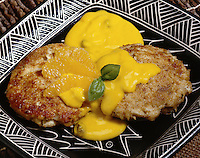 Curry Crab Cakes with orange slices
