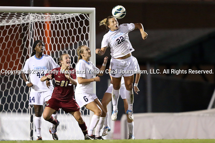 04 October 2012: UNC's Amber Brooks (22) heads the ball over UNC's Summer Green (6) and Satara Murray (44) and Boston College's Kate McCarthy (21). The University of North Carolina Tar Heels defeated the Boston College Eagles 1-0 at Fetzer Field in Chapel Hill, North Carolina in a 2012 NCAA Division I Women's Soccer game.