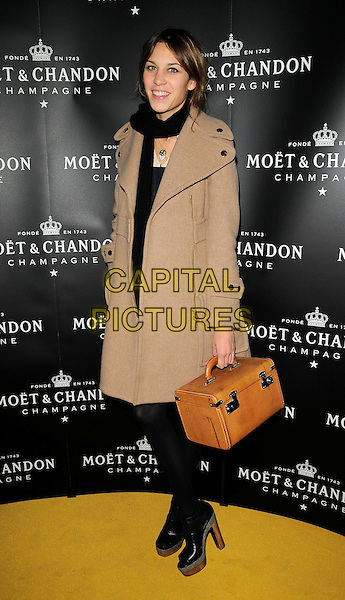 ALEXA CHUNG.Attending the Atelier Moet New Boutique launch Party, 70 New Bond Street, London, England, 3rd December 2008..full length beige brown coat bag  vanity case black tights scarf  shoes open toe platforms .CAP/CAN.©Can Nguyen/Capital Pictures