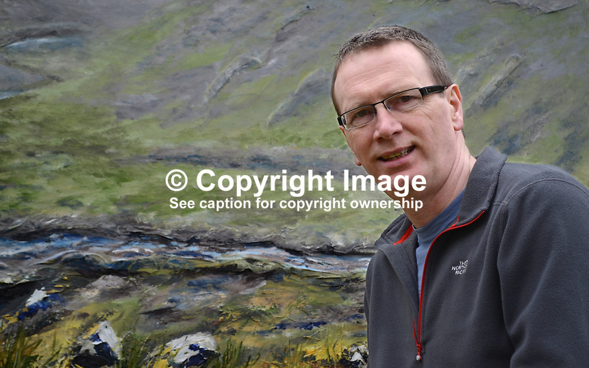 Keith Ayton, N Ireland artist, who is currently holding an exhibition in the Linen Hall Library, Belfast, N Ireland, which runs until the 30th March, 2013. Keith is a native of Derry/Londonderry but resident in Belfast. 201203041232..Copyright Image from Victor Patterson, 54 Dorchester Park, Belfast, UK, BT9 6RJ..Tel: +44 28 9066 1296.Mob: +44 7802 353836.Voicemail +44 20 8816 7153.Skype: victorpattersonbelfast.Email: victorpatterson@me.com.Email: victorpatterson@ireland.com (back-up)..IMPORTANT: If you wish to use this image or any other of my images please go to www.victorpatterson.com and click on the Terms & Conditions. Then contact me by email or phone with the reference number(s) of the image(s) concerned.