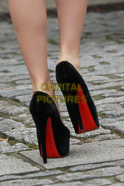Lady Gaga's shoes (Stefani Joanne Angelina Germanotta).leaving the her London hotel, London,  England, UK, November 12th 2011..detail feet red soles  black   platform shoes christian louboutin heels.CAP/HIL.©John Hillcoat/Capital Pictures