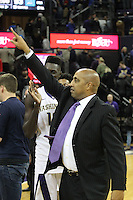 JAN 1, 2016:  Washington head coach Lorenzo Romar points to the fans after the Huskies upset UCLA.  Washington defeated #25 ranked UCLA 96-93 in double overtime at Alaska Airlines Arena in Seattle, WA.