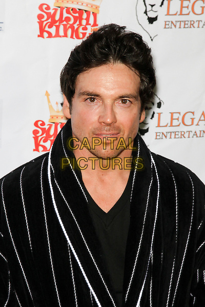 JASON GEDRICK.Decked out in pajamas, celebrities arrive to Bowling After Dark, an event to benefit the Carol M. Baldwin Breast Cancer Research Fund, at Pinz Bowling Center in Studio City, CA, USA. .February 13th, 2010.headshot portrait black striped stripes bathrobe white .CAP/CEL.©CelPh/Capital Pictures.