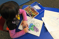 STAFF PHOTO FLIP PUTTHOFF <br /> Genevieve LaPlant does coloring on Wednesday Dec. 31 2014 at KIDcare.