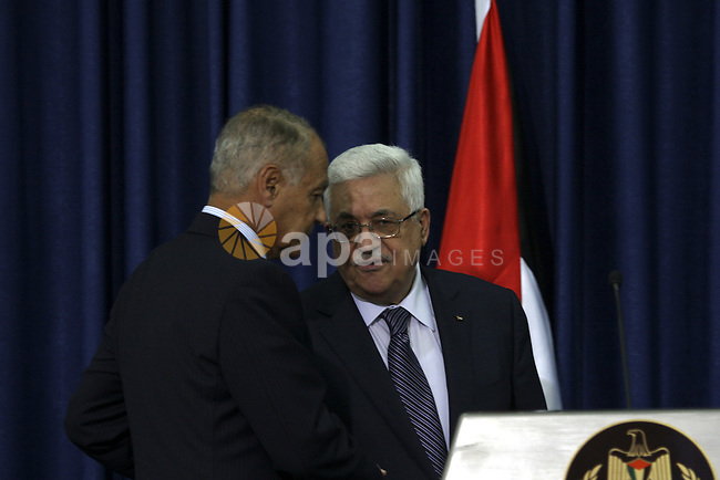 Palestinian President Mahmoud Abbas shakes hand with Egyptian Foreign Minister Ahmed Aboul Gheit during a joint press conference , in the West Bank city of Ramallah, Thursday, Oct. 28, 2010. Egypt's foreign minister says there has been no breakthrough in restarting Israeli-Palestinian talks, which have run aground over Israeli settlement building. Aboul Gheit is on an official visit to the region. Photo by Eyad Jadallah
