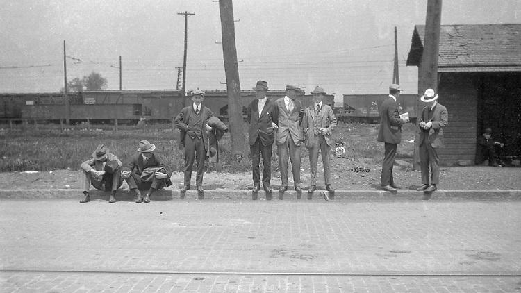 A group of men wait along the road. Proably near Niagara Falls, New York. 1924.