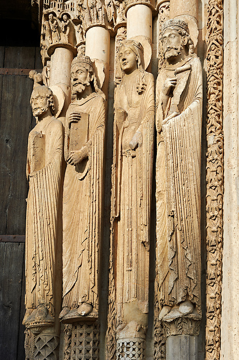 West Facade, Central Portal - Right Jamb Figures- General View c. 1145. Cathedral of Chartres, France . Gothic statues of figures that some scholars believe that the jamb figures are the ancestors of Christ.. A UNESCO World Heritage Site.