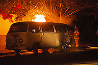 Sunday, June 20, 2010:  San Diego Firefighters from Station 13 respond to a vehicle fire on the corner of Opal and Dawes at approximately 9pm Sunday night.  The owner of the van, Steve Ferguson believes the fire started due to a battery short in the engine compartment.  Ferguson, who has lived in the van for the past couple of years escaped the fire unharmed but most of his possesions and the vehicle were a complete loss.