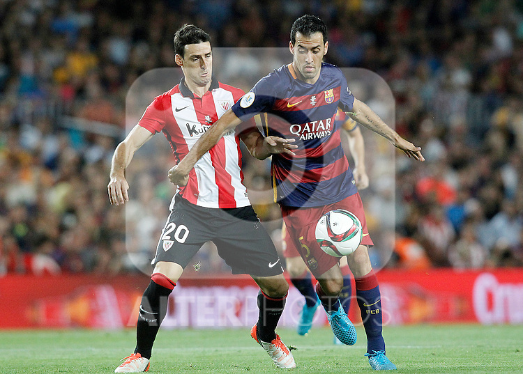 FC Barcelona's Sergio Busquets (r) and Athletic de Bilbao's Aritz Aduriz during Supercup of Spain 2nd match.August 17,2015. (ALTERPHOTOS/Acero)