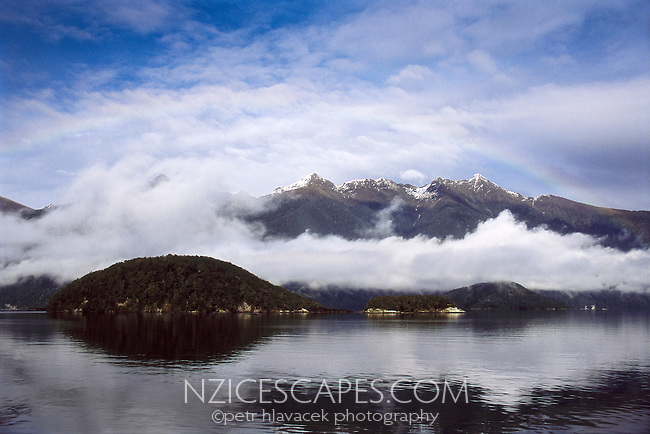 Lake Manapouri near Te Anau with clouds just above the water  - Fiordland National Park