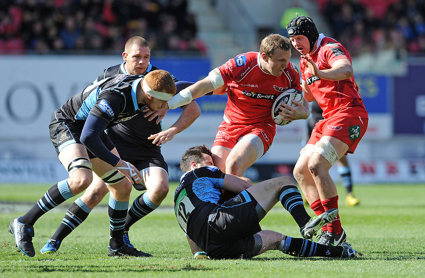 Scarlets' Hadleigh Parkes is tackled by Glasgow Warriors' Alex Dunbar<br /> <br /> Photographer Ian Cook/CameraSport<br /> <br /> Rugby Union - Guinness PRO12 Round 20 - Scarlets v Glasgow Warriors - Saturday 16th April 2016 - Parc y Scarlets - Llanelli <br /> <br /> &copy; CameraSport - 43 Linden Ave. Countesthorpe. Leicester. England. LE8 5PG - Tel: +44 (0) 116 277 4147 - admin@camerasport.com - www.camerasport.com