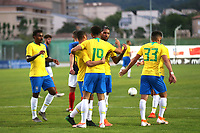 Brazil players congratulate Matheus Cunha (No 19) after scoring their third goal from the penalty spot during France Under-18 vs Brazil Under-20, Tournoi Maurice Revello Football at Stade d'Honneur Marcel Roustan on 5th June 2019