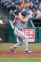 Javier Guerra (31) of the Greenville Drive follows through on his swing against the Greensboro Grasshoppers at NewBridge Bank Park on August 17, 2015 in Greensboro, North Carolina.  The Drive defeated the Grasshoppers 5-4 in 13 innings.  (Brian Westerholt/Four Seam Images)