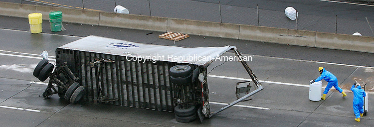WATERBURY, CT-29November 2006-112906TK19-  Workers cleaning up a spill that removed 300 gallons of potassium hydroxide solution from I-84 eastbound lane between exits 22 and 23. Tom Kabelka Republican-American (potassium hydroxide)