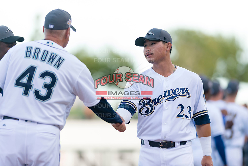 AFL West second baseman Keston Hiura (23), of the Peoria Javelinas and Milwaukee Brewers organization, shakes hands with manager Daren Brown (43) during player introductions before the Arizona Fall League Fall Stars game at Surprise Stadium on November 3, 2018 in Surprise, Arizona. The AFL West defeated the AFL East 7-6 . (Zachary Lucy/Four Seam Images)