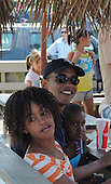 Oak Bluffs, MA - August 26, 2009 -- United States President Barack Obama and his daughters Sash and Malea stop to pick up a a take-out lunch of fried seafood at Nancy's Restaurant in Oak Bluffs, Massachusetts on the island of Martha's Vineyard, Wednesday, August 26, 2009.  .Credit: Neal Hamberg - Pool via CNP