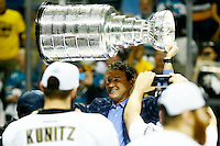 Mario Lemieux of the Pittsburgh Penguins hoists the Stanley Cup following their 3-1 win against the San Jose Sharks during game six of the Stanley Cup Final at SAP Center in San Jose, California on June 12, 2016. (Photo by Jared Wickerham / DKPS)