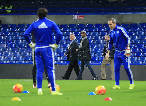 19.12.2015. Stamford Bridge, London, England. Barclays Premier League. Chelsea versus Sunderland. New Chelsea manager Guus Hiddink and ex player Didier Drogba  walk around the edge of the pitch at the final whistle.