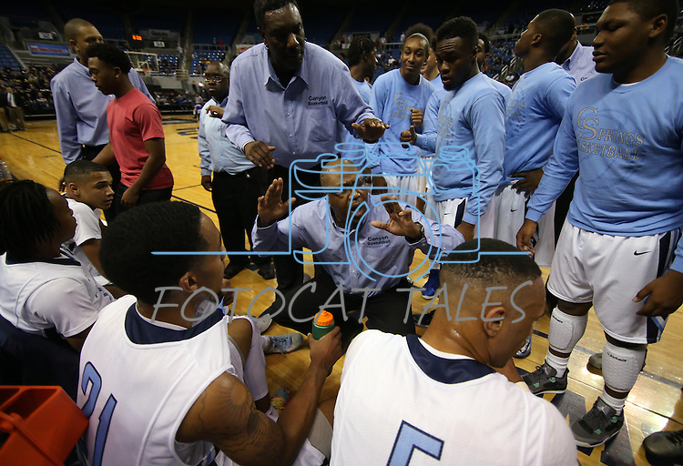 Canyon Springs Head Coach Freddie Banks talks to his team during a time out in a Division I semi-final game in the NIAA basketball state tournament at Lawlor Events Center, in Reno, Nev., on Thursday, Feb. 27, 2014. Canyon Springs defeated Spanish Springs 66-51. (Cathleen Allison/Las Vegas Review-Journal)