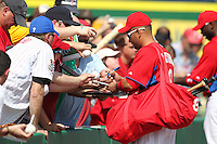 Philadelphia Phillies Shane Victorino #8 signs autographs before a scrimmage vs the Florida State Seminoles  at Bright House Field in Clearwater, Florida;  February 24, 2011.  Philadelphia defeated Florida State 8-0.  Photo By Mike Janes/Four Seam Images