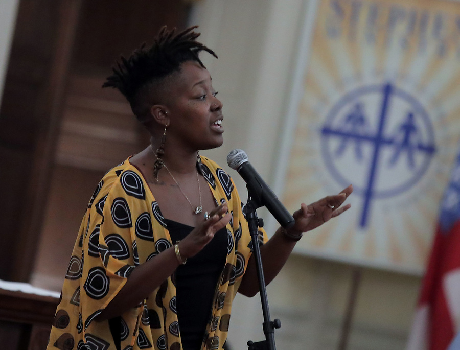 Singer Yolanda Jones performs during a Mass Prayer Service Friday at St. Paul's Memorial in Charlottesville, Va. Dr. Cornell West was the featured speaker at the event. Photo/Andrew Shurtleff