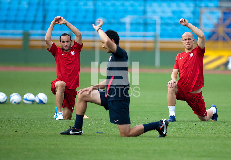 (Left to right): Landon Donovan and  Michael Bradley stretch before practice at Estadio Mateo Flores in Guatemala City, Guatemala on Mon. June 11, 2012.  The USA will face Guatemala in a World Cup Qualifier on Tuesday.