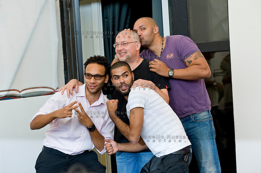 French film director Philippe Faucon (C) poses with actors Yassine Azzouz (L) Rashid Debbouze (2D-L) and Kamel Laadaili during the photocall of 'La desintegration' at the 68th Venice Film Fest