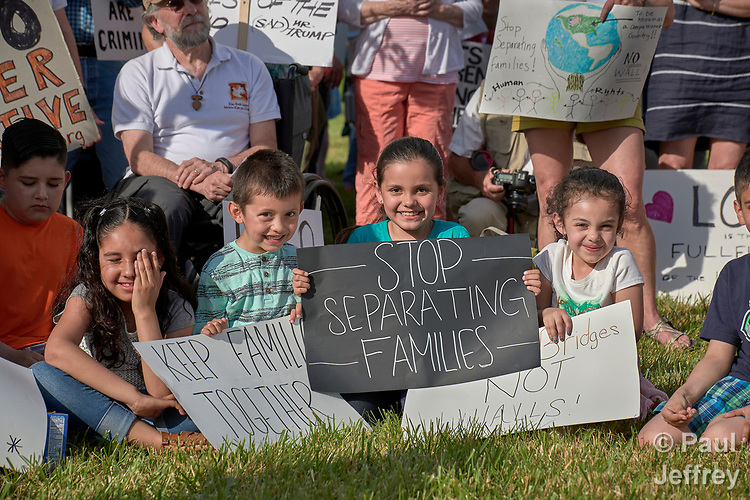 Children participate in a rally outside a federal detention center in Sheridan, Oregon. Participants protested the Trump administration's policy of separating parents from their children at the U.S.-Mexico border.