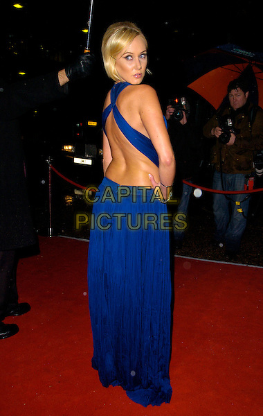KIMBERLEY STEWART.The Red Cross London Ball, The Room By The River, London, England..November 21st, 2007.full length blue dress hand on hip kimberly looking over shoulder backless.CAP/CAN.©Can Nguyen/Capital Pictures