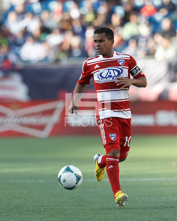 FC Dallas midfielder David Ferreira (10) looks to pass..  In a Major League Soccer (MLS) match, FC Dallas (red) defeated the New England Revolution (blue), 1-0, at Gillette Stadium on March 30, 2013.