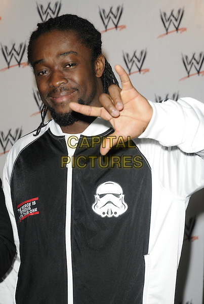 KOFI KINGSTON.The WWE photocall & toy signing session, Harrods, Knightsbridge, London, England..April 19th, 2011.half length stormtrooper black adidas white jacket goatee facial hair hand gesture .CAP/CAN.©Can Nguyen/Capital Pictures.