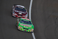 Mar 1, 2008; Las Vegas, NV, USA; Nascar Nationwide Series driver Kyle Busch (18) leads Tony Stewart (20) during the Sams Town 300 at the Las Vegas Motor Speedway. Mandatory Credit: Mark J. Rebilas-US PRESSWIRE