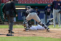 Kane County Cougars pinch runner Jorge Perez (16) slides under the tag of Ben Rodriguez (23) during a Midwest League game against the Cedar Rapids Kernels at Northwestern Medicine Field on April 28, 2019 in Geneva, Illinois. Perez was ruled safe on the play. Kane County defeated Cedar Rapids 3-2 in game one of a doubleheader. (Zachary Lucy/Four Seam Images)