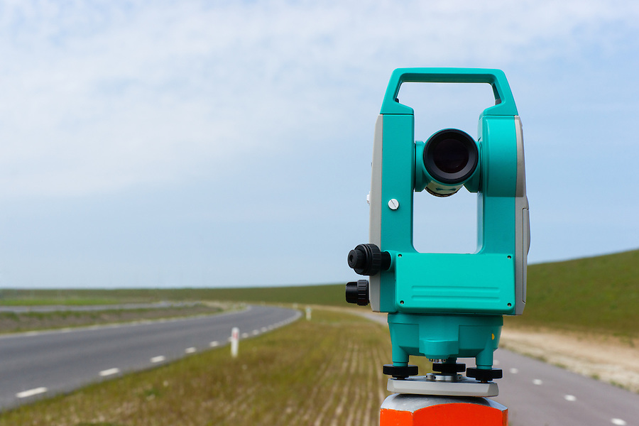 A moderne theodolite or total station on a tripod