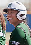 April 20, 2012:   University of Hawai'i Warrior Jessica Iwata smiles after hitting the first of two home runs against the Nevada Wolf Pack during their NCAA softball game played at Christina M. Hixson Softball Park on Friday in Reno, Nevada.