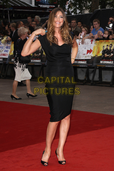 "LISA SNOWDON .""The Expendables"" UK Film Premiere, Odeon Leicester Square, London, England. .August 9th, 2010 .full length black dress hand on hip open peep toe shoes patent Christian Louboutin smiling .CAP/AH.©Adam Houghton/Capital Pictures."