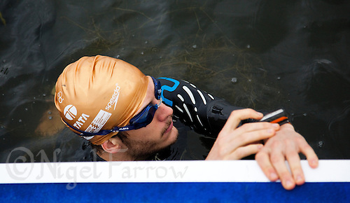25 JUL 2010 - LONDON, GBR - A competitor waits for the start of his wave during the Age Group races of the London round of the ITU World Championship Series triathlon (PHOTO (C) NIGEL FARROW)