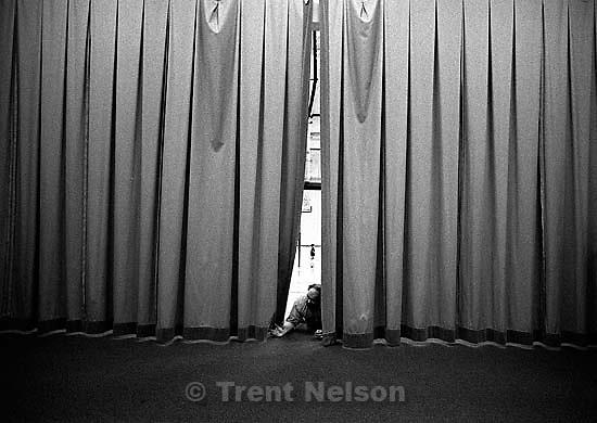 Director Rudy Shenks peeks through the curtain at Bryan Ward roadshow rehearsal.<br />