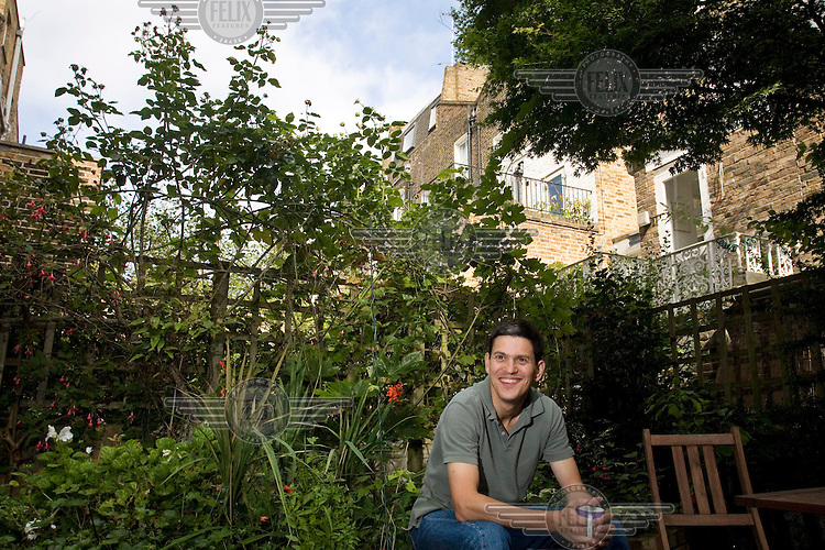 David Miliband, British Foreign and Commonwealth Secretary, in the garden at his home in London.