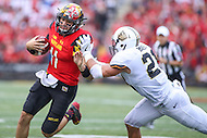 College Park, MD - October 1, 2016: Maryland Terrapins quarterback Perry Hills (11) is pushed out of bounds by Purdue Boilermakers linebacker Markus Bailey (21) during game between Purdue and Maryland at  Capital One Field at Maryland Stadium in College Park, MD.  (Photo by Elliott Brown/Media Images International)